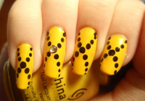 Yellow and Black Totted Nail Polish for Female